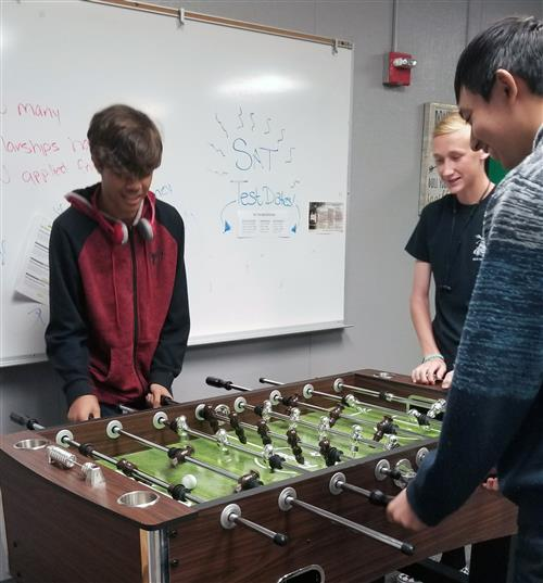 Students Playing on the new donated Foosball table